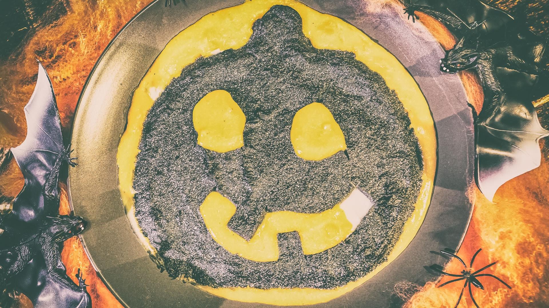 Foto Polenta Nera al Carbone in Salsa di Zucca
