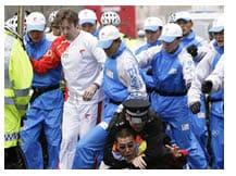Fiamma olimpica proteste